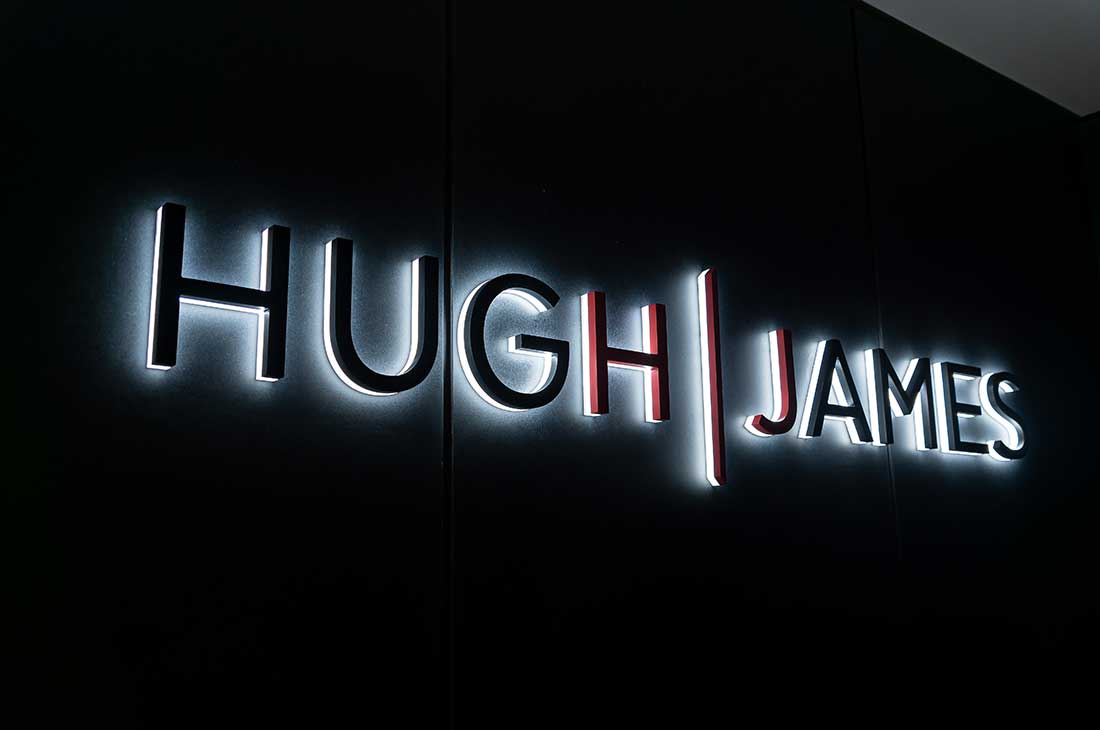 Huw James Solicitors illuminated logo