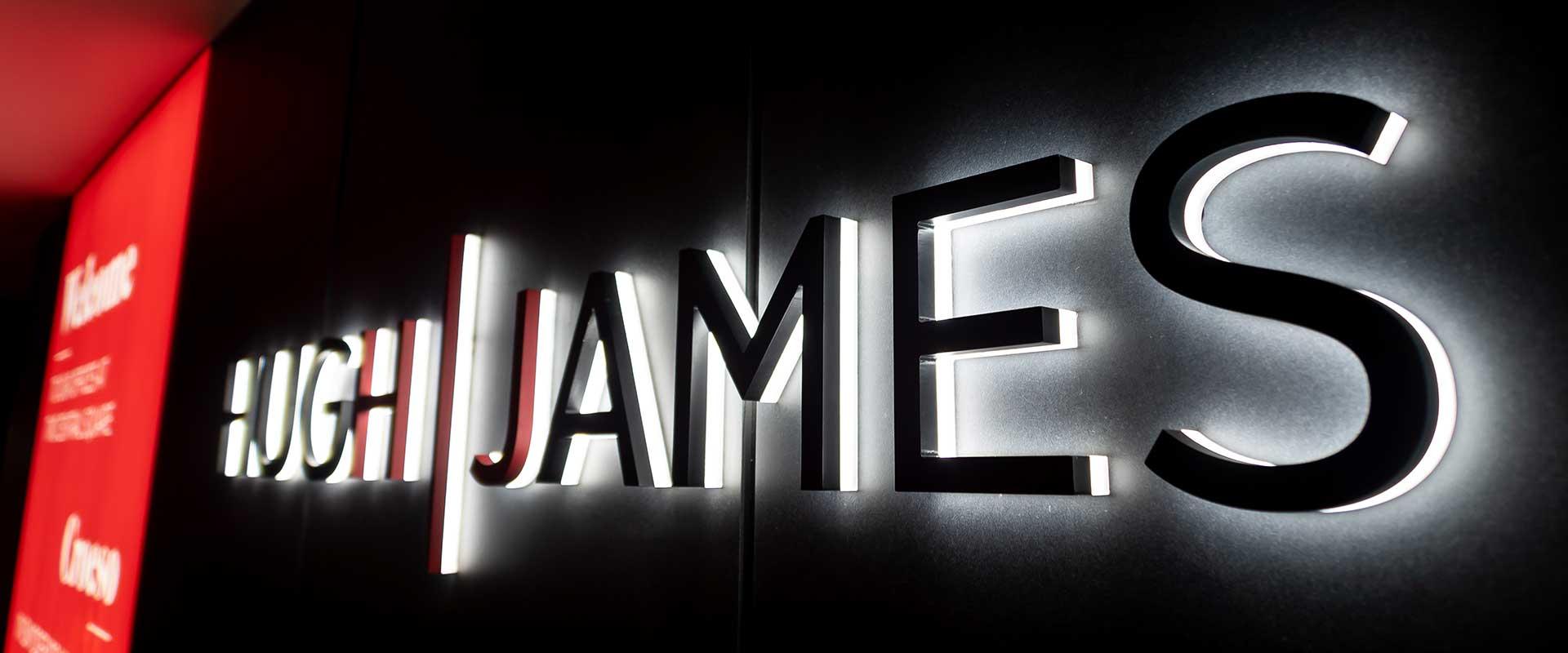 Huw James illuminated logo sign Cardiff