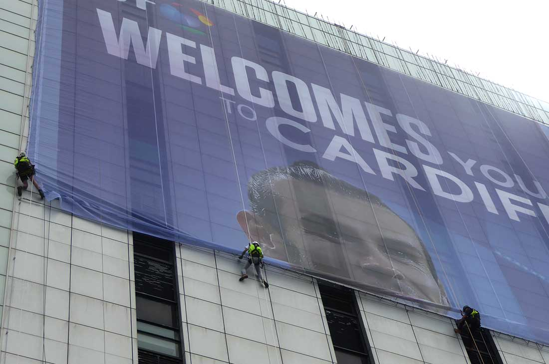 Champions League BT building Cardiff banner abseiling installation