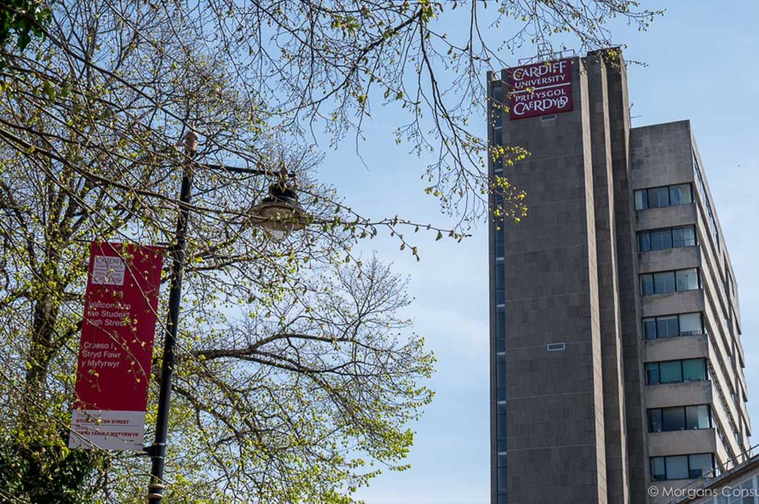 Cardiff University building logo branding and flags