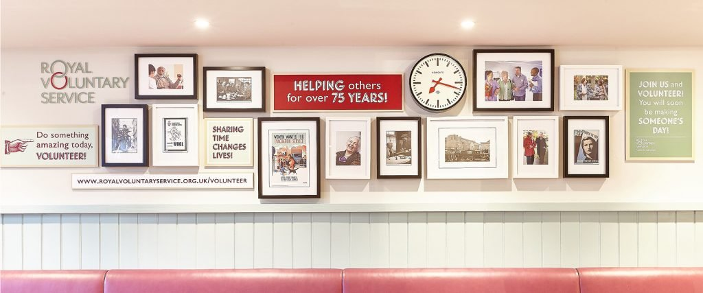 Royal Voluntary Service picture frame wall with branding