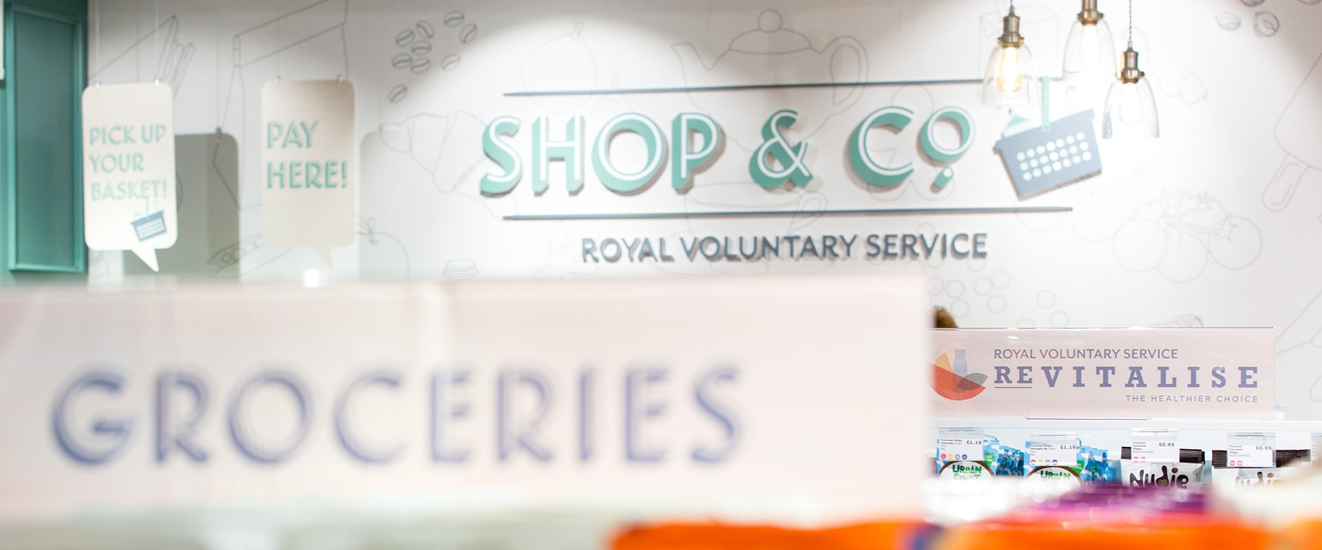 Royal Voluntary Service Shop & co wall logo branding signage