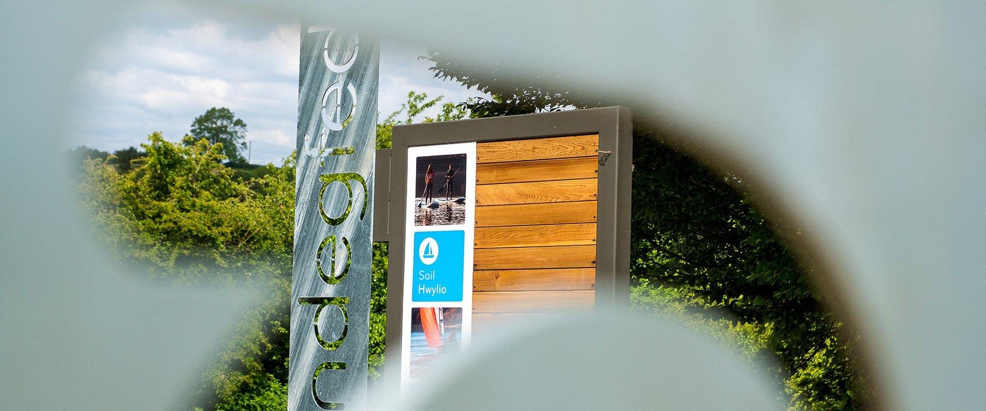 Dwr Cymru Welsh Water Llandegfedd visitor centre sign focus
