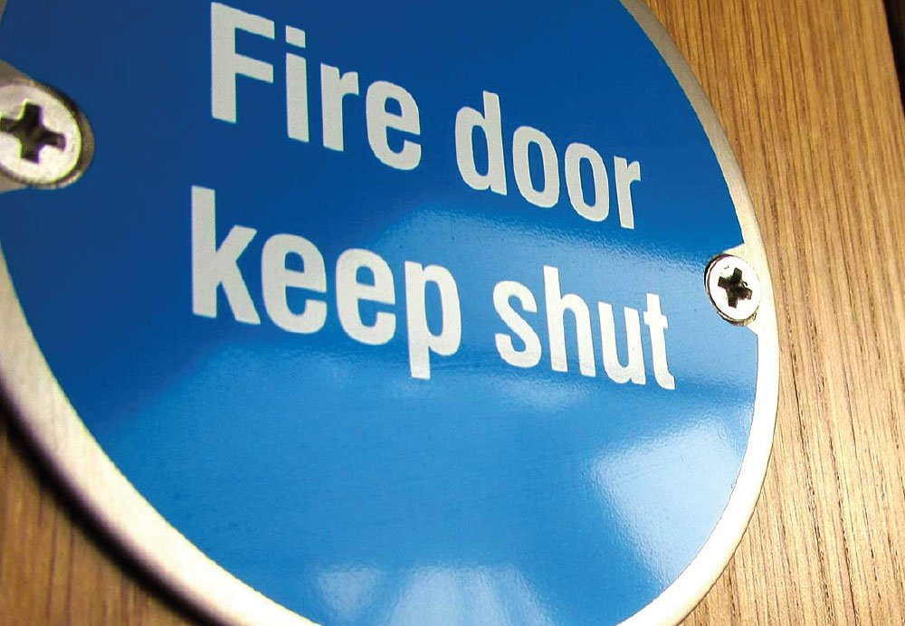 wayfinding fire door keep clear sign