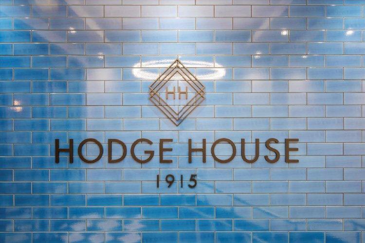 Hodge House blue wall logo