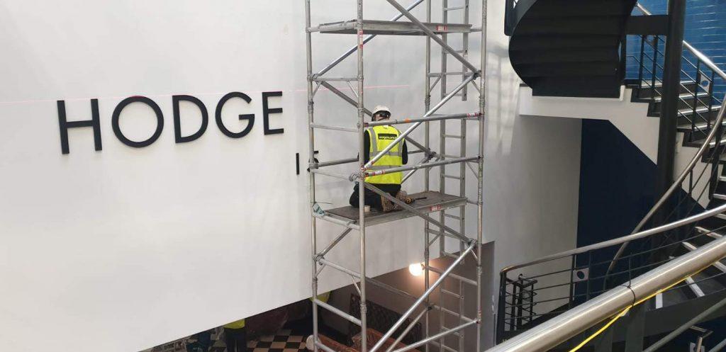 Hodge House wall logo fitting