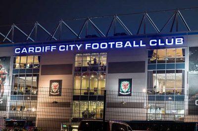 Cardiff City Football Club stadium signage illuminated